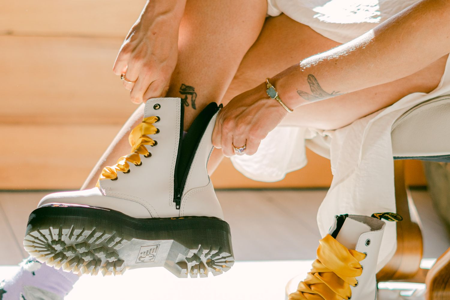 Detail of Bride putting on her wedding day Doc Martens