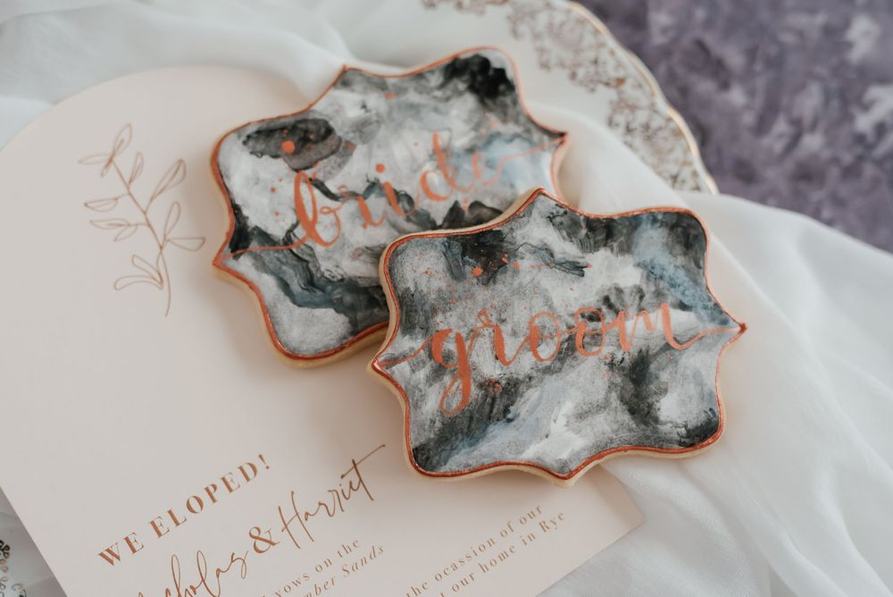 Bride and groom marble effect iced wedding biscuits