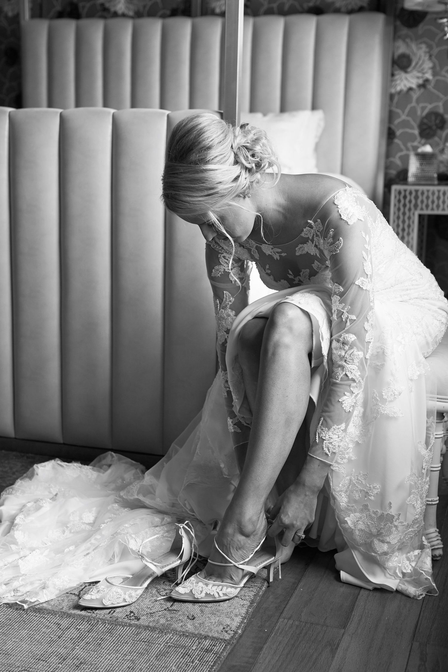 bride putting on her shoes wedding photo