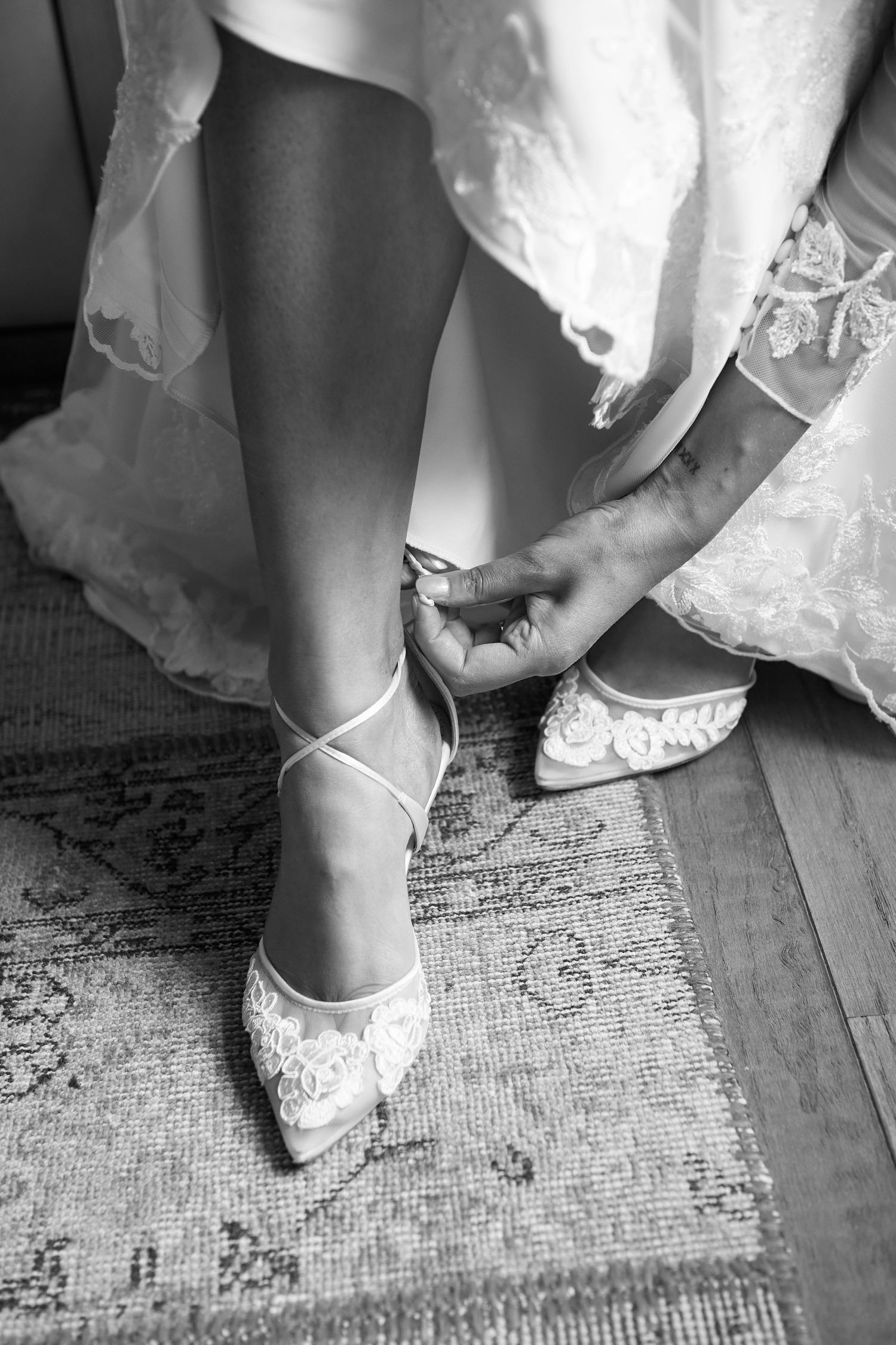 detail shot of bride putting on her shoes wedding photo