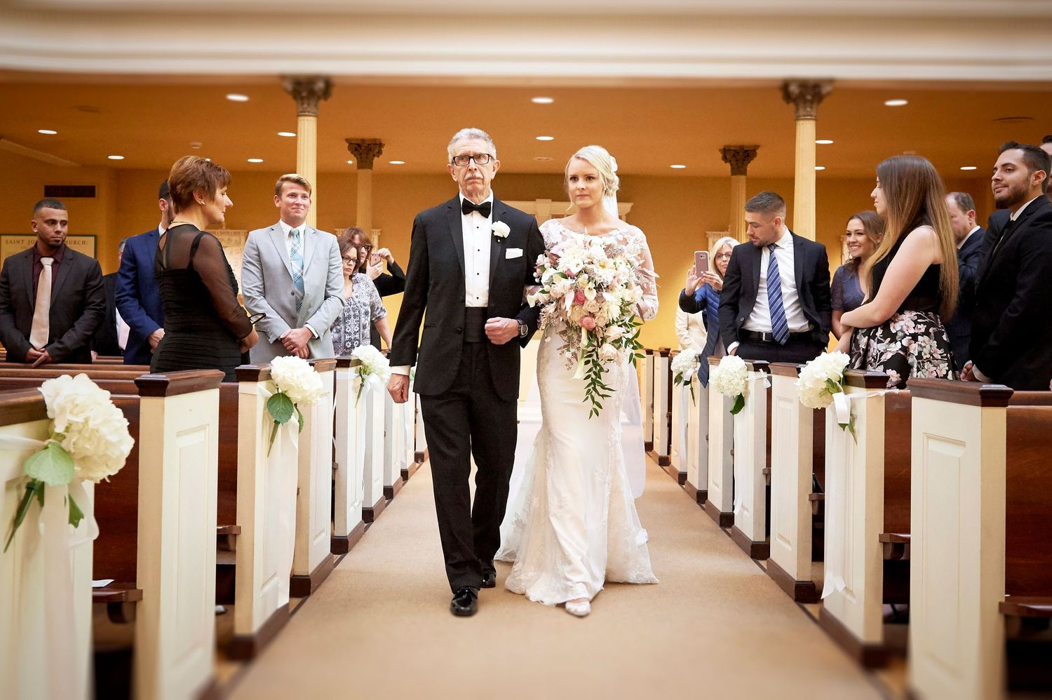 bride and father walking down the isle at Old St. Joseph's church in Philadelphia wedding photo wedding photo