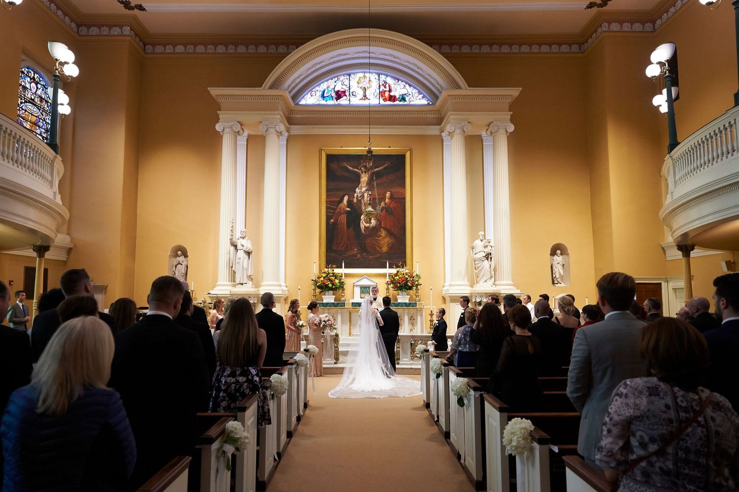 bride and groom at alter in Old St. Joseph's church in Philadelphia wedding photo
