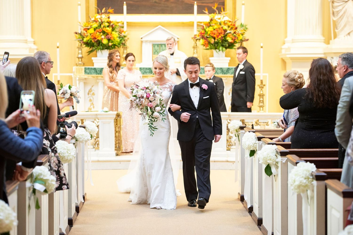 bride and groom recessional at Old St. Joseph's church in Philadelphia wedding photo