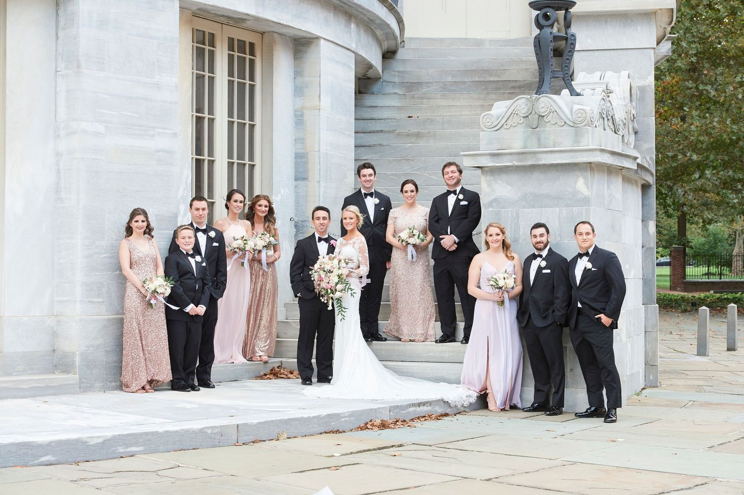full bridal party portrait at merchant exchange building in philadelphia wedding photo