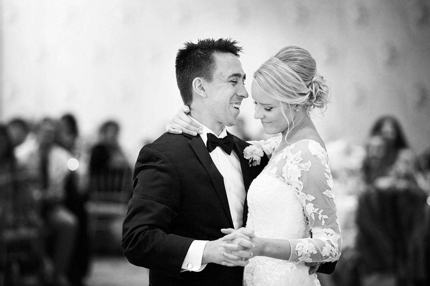 black and white first dance photo of bride and groom at Bucks Hotel wedding photo