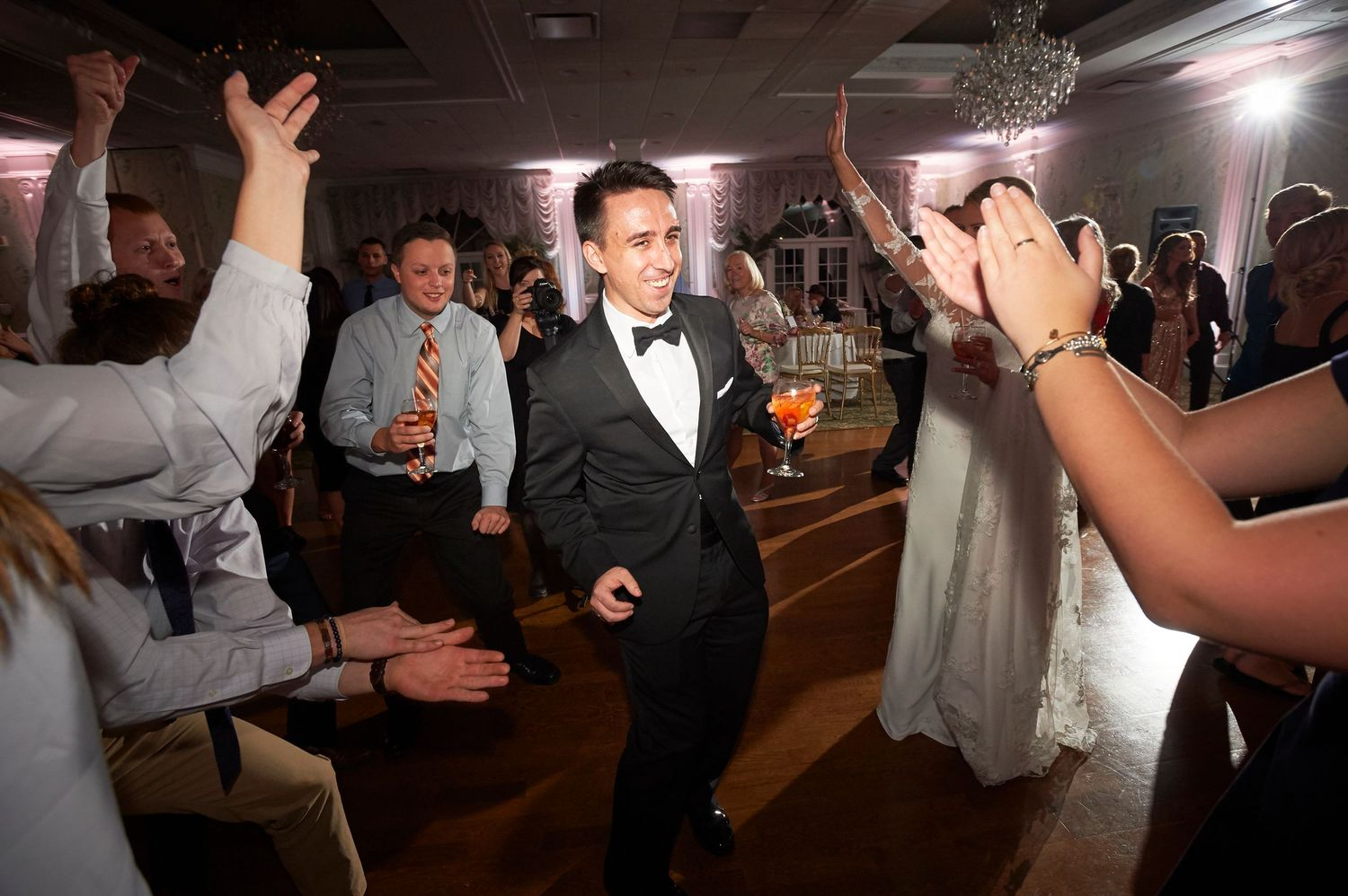 groom dances during reception at Bucks hotel wedding photo