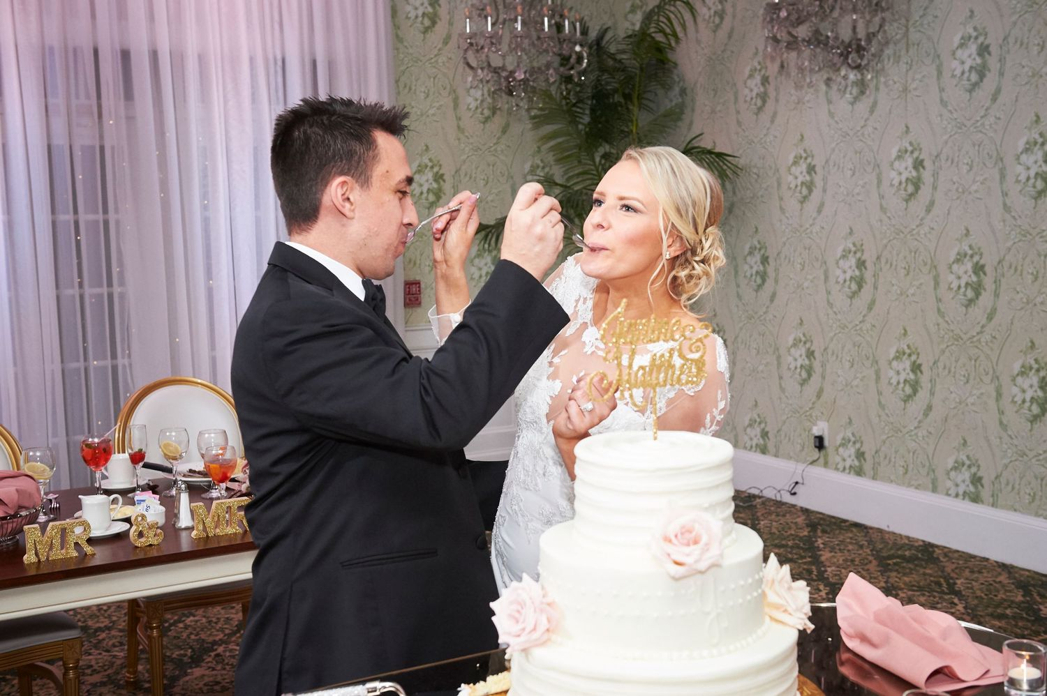 bride and groom feed each other cake at Bucks hotel wedding photo