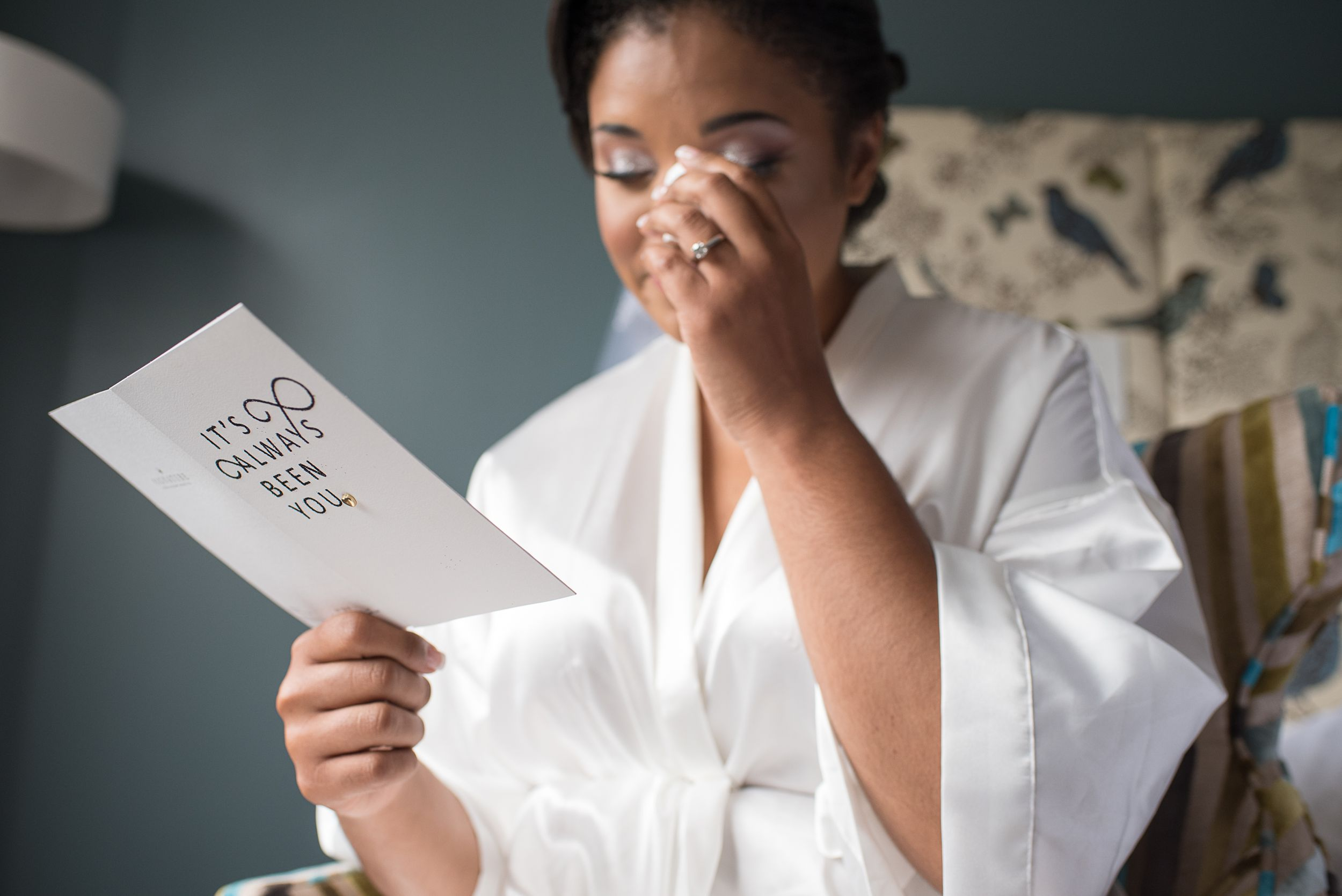 emotional moment of bride reading wedding day card from her fiance | Princeton Wedding Photographer