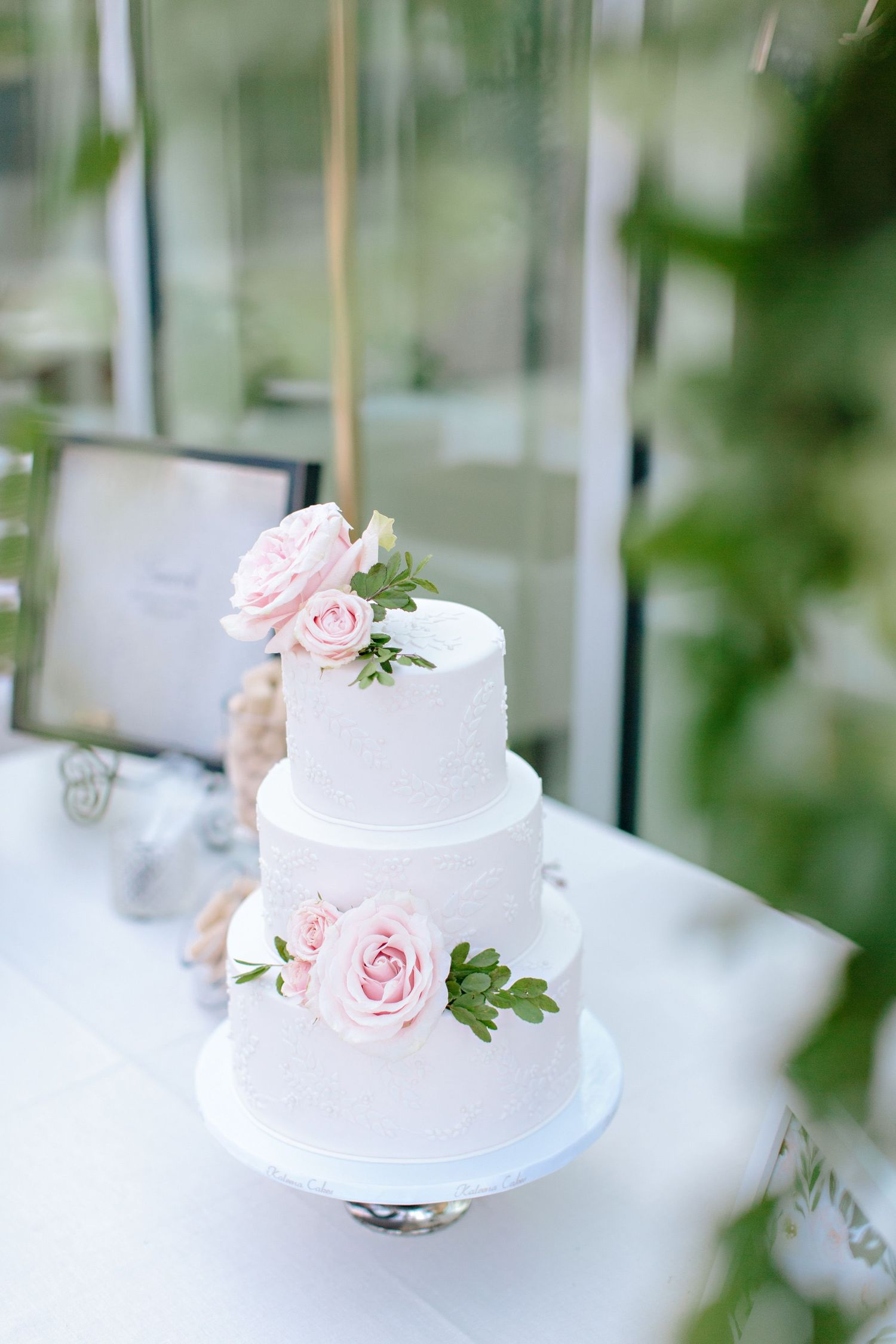 white cake with fresh florals