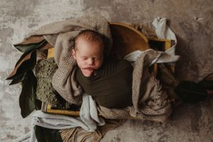 newborn session in Centralia, IL studio session, baby boy, foliage, wrapped