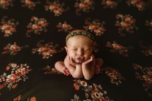 newborn session in Centralia, IL studio session, baby girl, foliage, froggy pose, floral backdrop, olive green