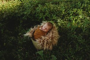 newborn session in Centralia, IL studio session, outdoor boy, foliage, wrapped