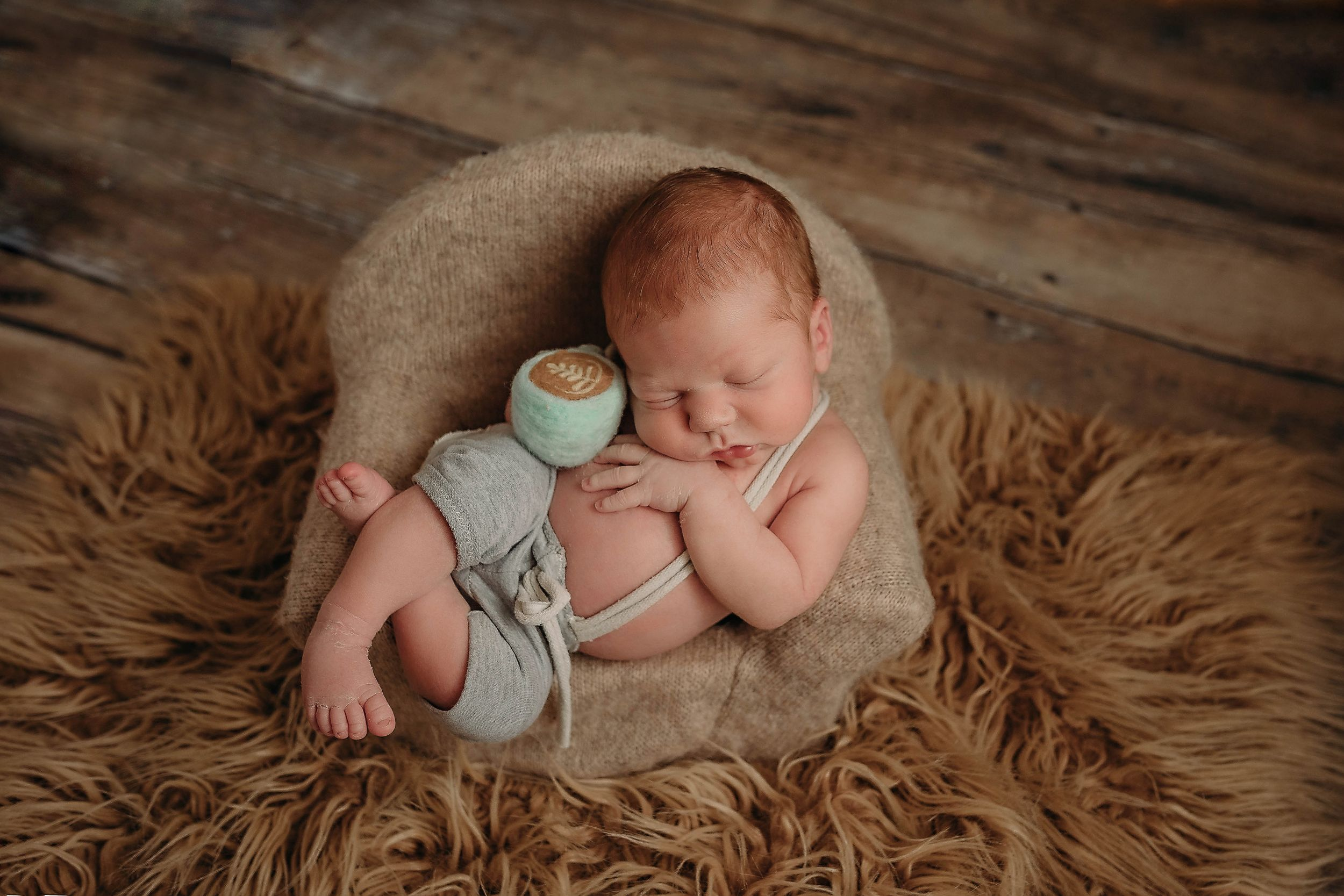 newborn session in Centralia, IL studio session, baby boy, siblings, foliage, newborn prop, advanced posing,
