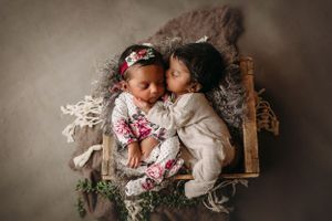 newborn session in Centralia, IL studio session, baby girl and boy, siblings, foliage, wrapped