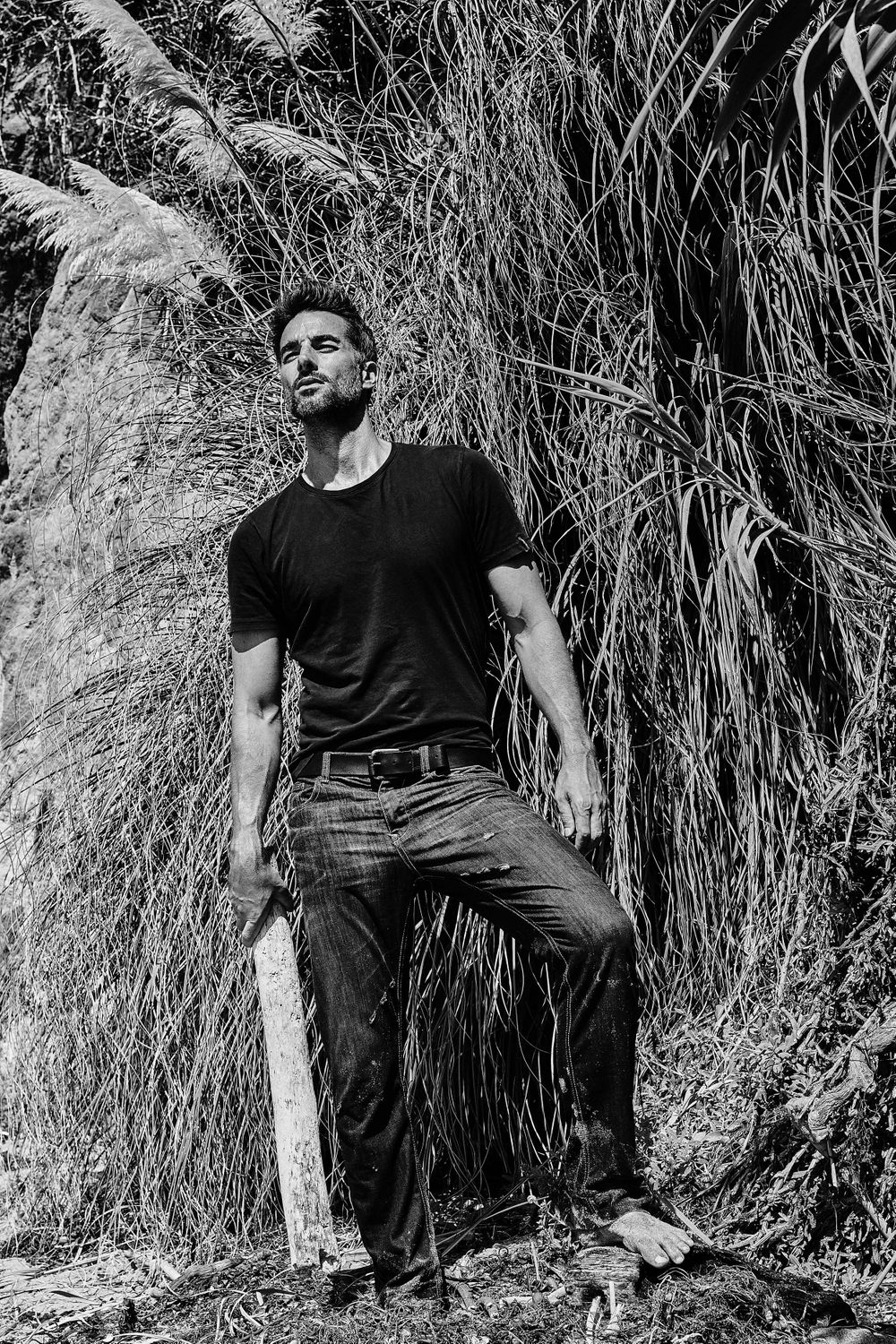 Model Colin Devitt from LA Models wearing denim jeans and black t shirt El Matador tall grass