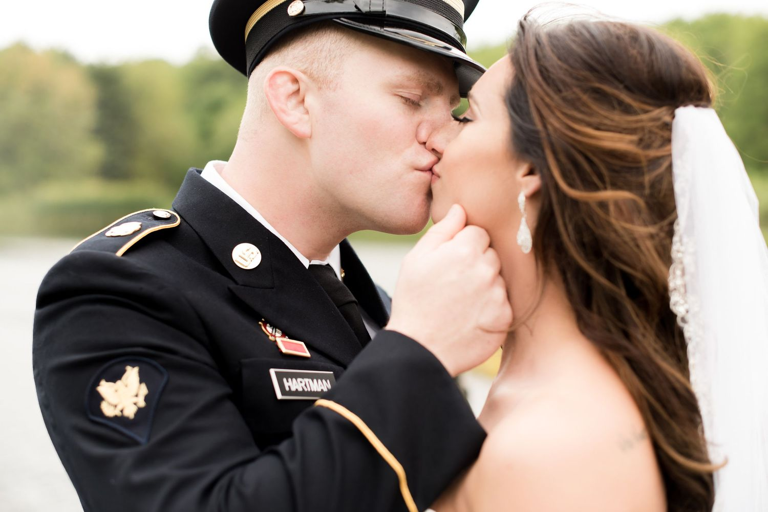 Bride and Military groom kissing at wedding at the Hayloft in Rockwood, PA