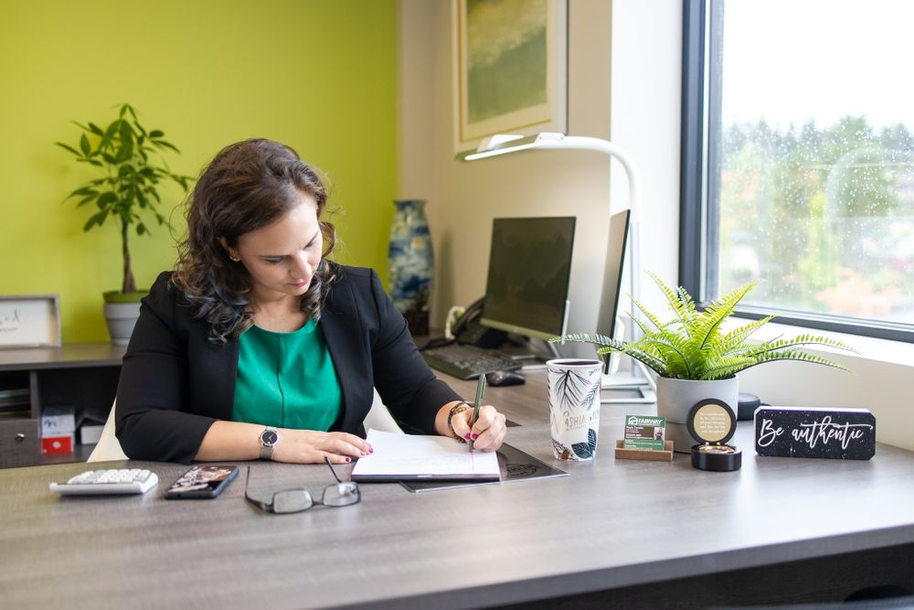 Office branding headshot federal way woman loan officer sitting at desk