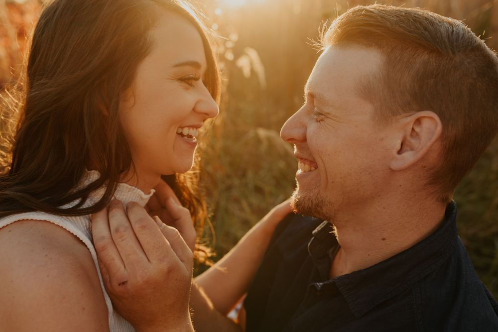 Engagement Photography Kansas City Blog Man and woman gazing in each others eyes sunset behind them smiling