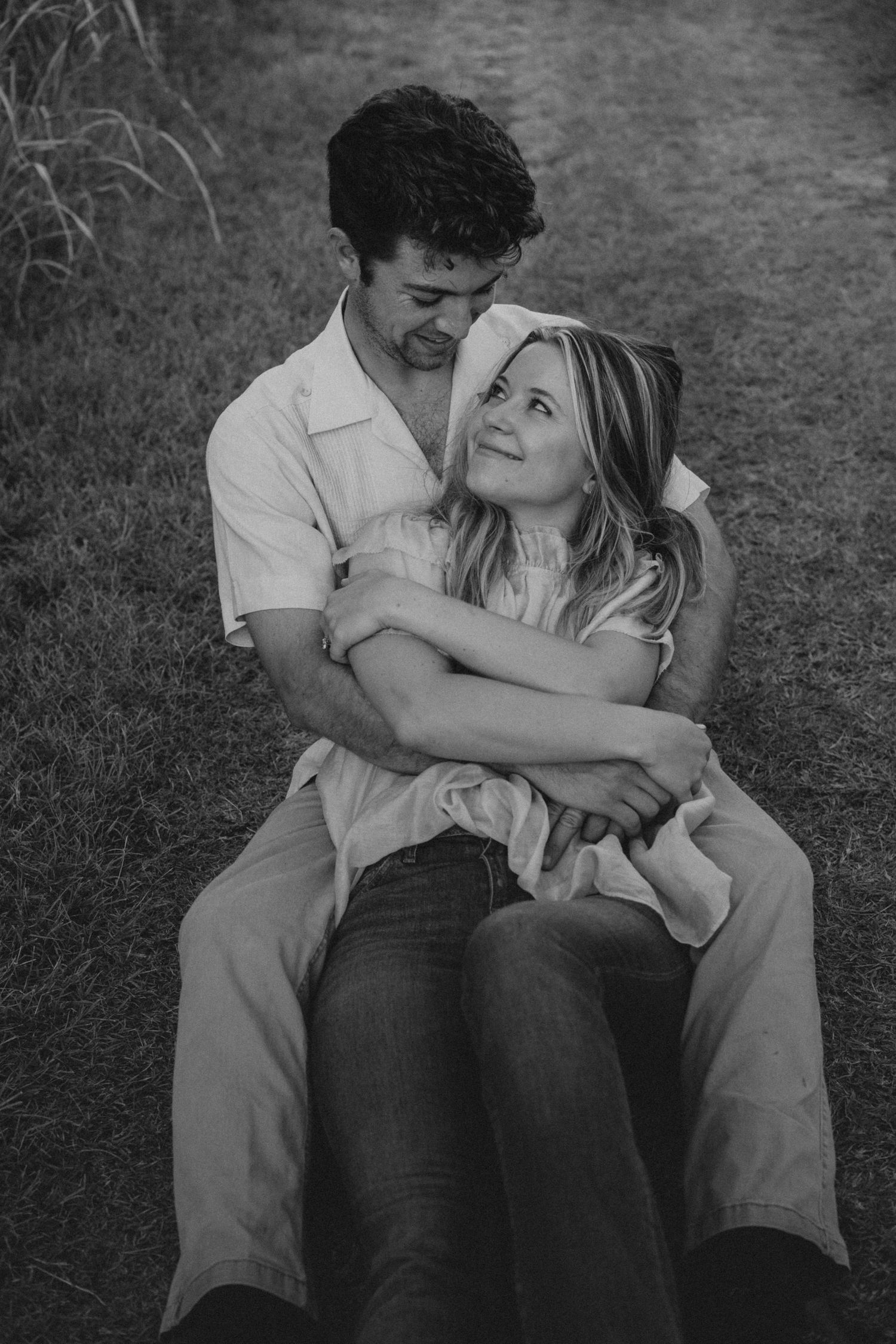 photo taken by Kelsie Burke Photography of a Couple in Austin, TX in each others arms on a dirt road
