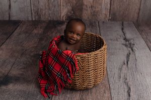 Little Brown Rabbit Photography - Baby photographer in Perth - smiling boy in a red shawl and basket