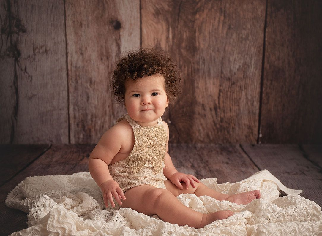 Little Brown Rabbit Photography - Baby photographer in Perth - 6 month old girl in gold romper