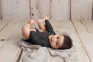 Little Brown Rabbit Photography - Baby photographer in Perth - 6 month old boy lying on the floor