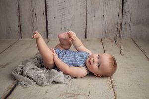 Little Brown Rabbit Photography - Baby photographer in Perth - baby on floor with tongue out