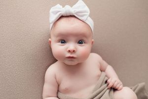 Little Brown Rabbit Photography - Baby photographer in Perth - young baby with big white bow