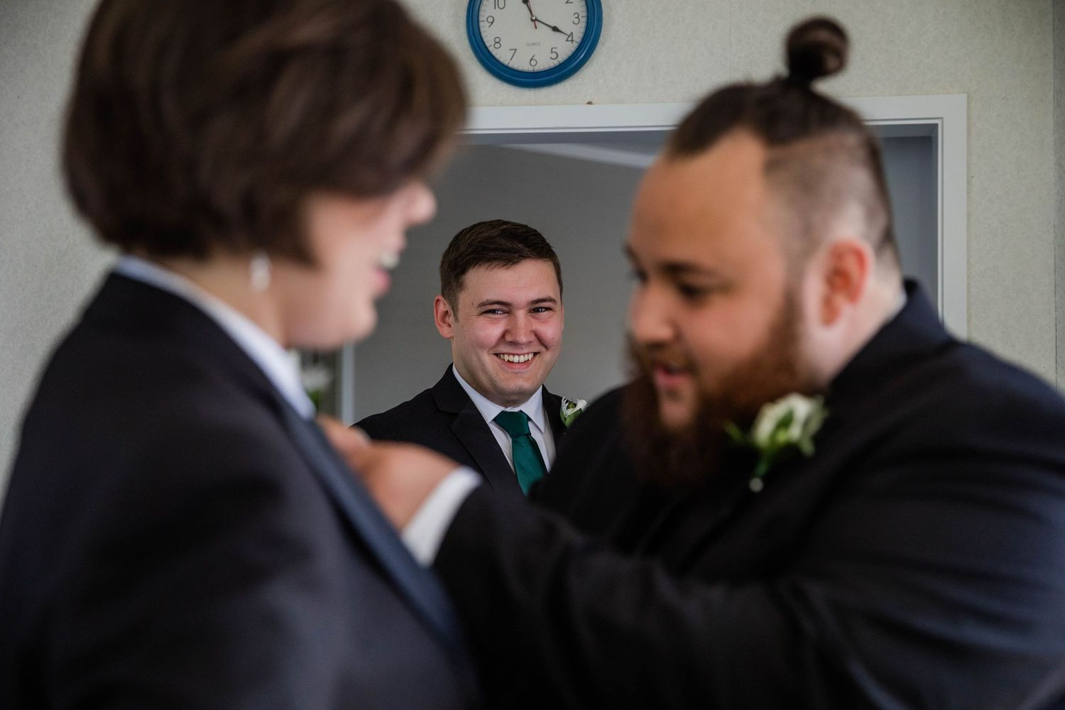Groom putting on Button holes