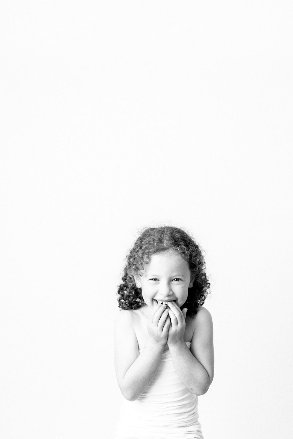black and white of a girl giggling