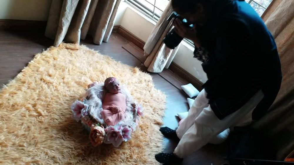 Newborn photographer taking photo of baby in Lahore