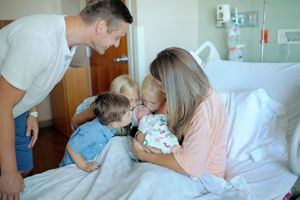 siblings meet baby in hospital