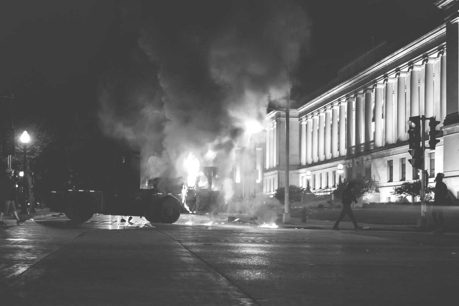 A garbage truck burns near the Kenosha County Courthouse.
