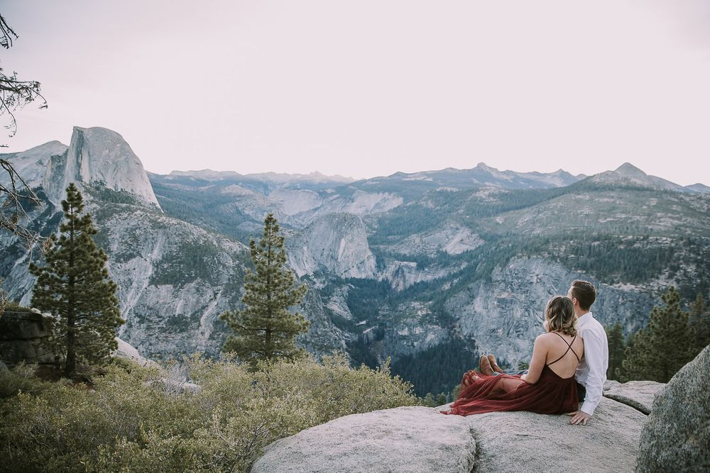 couple enjoying the view of half dome