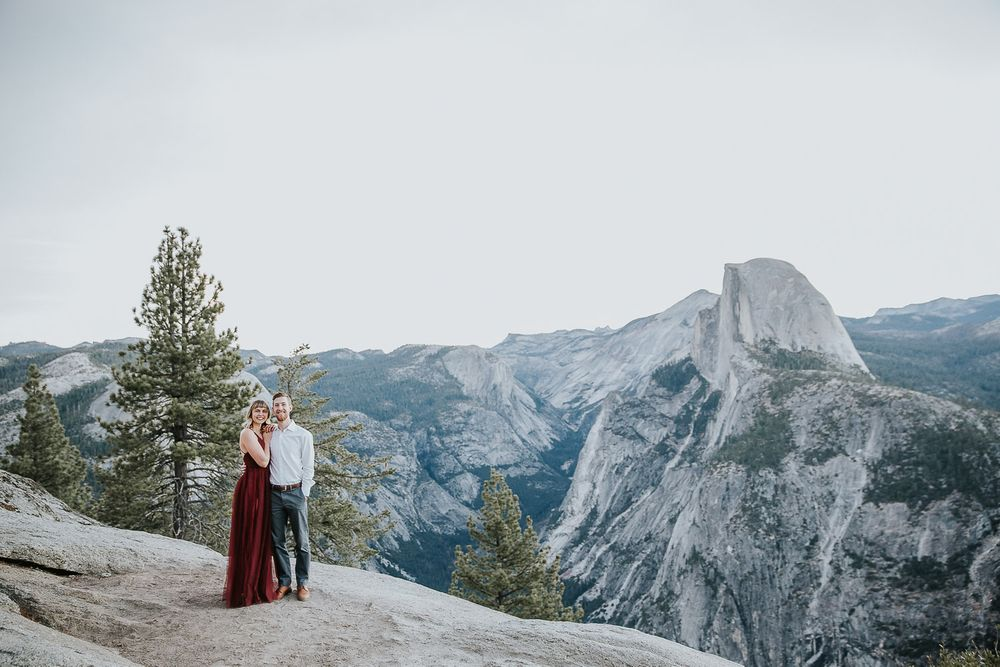 engaged couple with halfdome in the background