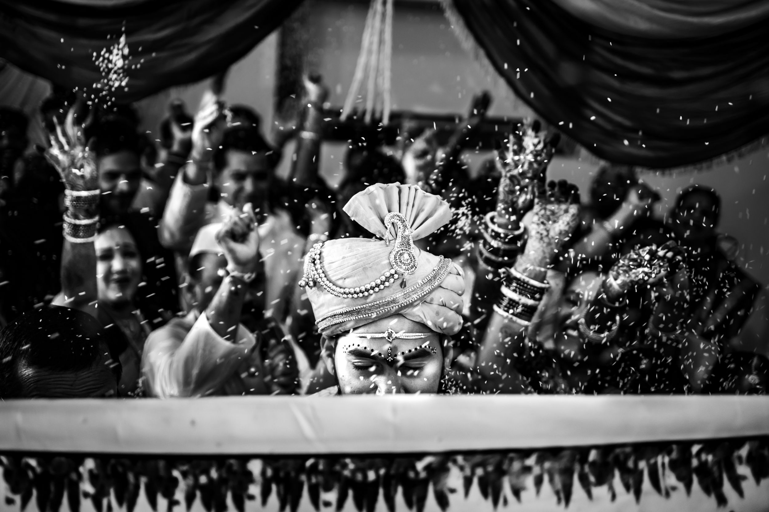 Rise showing on groom in Indian wedding ritual a black & white tone