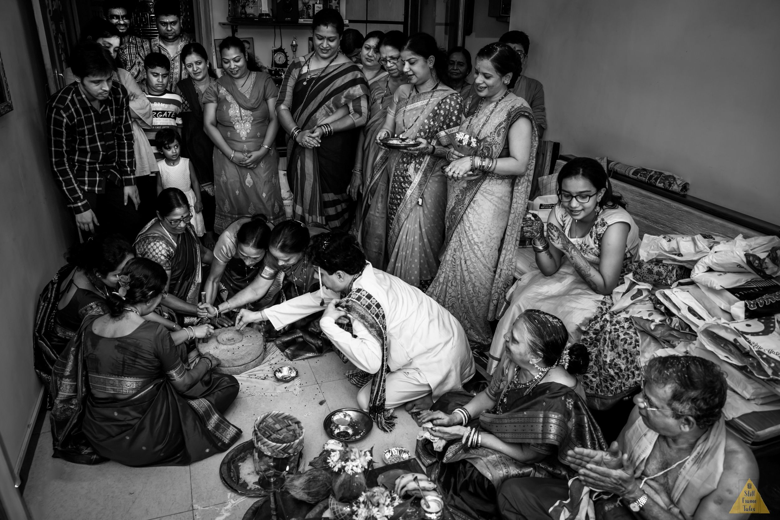 Family & groom performing wedding day ritual at home