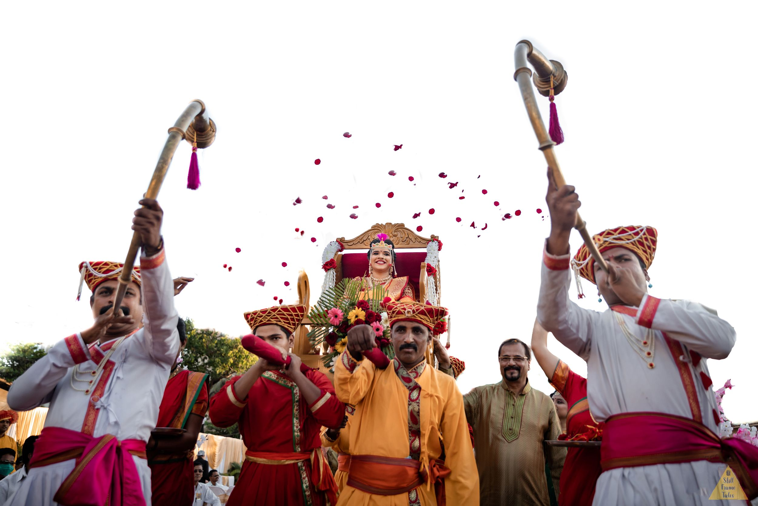 Grand entry of bride with rose petals shower and doli at destination wedding