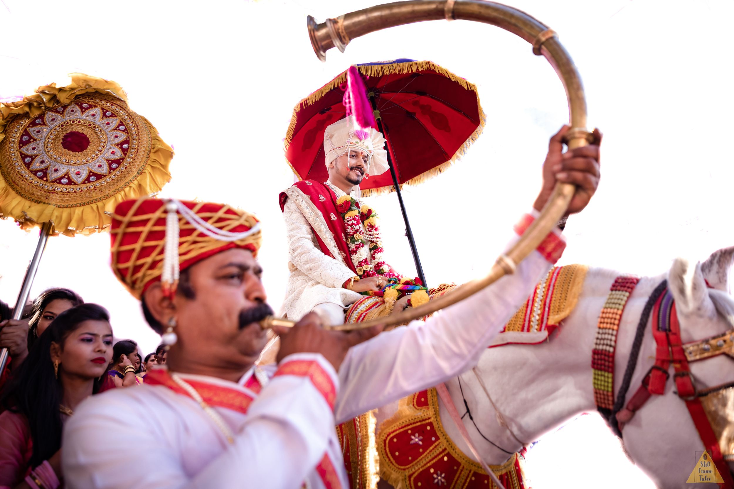 groom on horse with shehnai in barat on destination wedding day