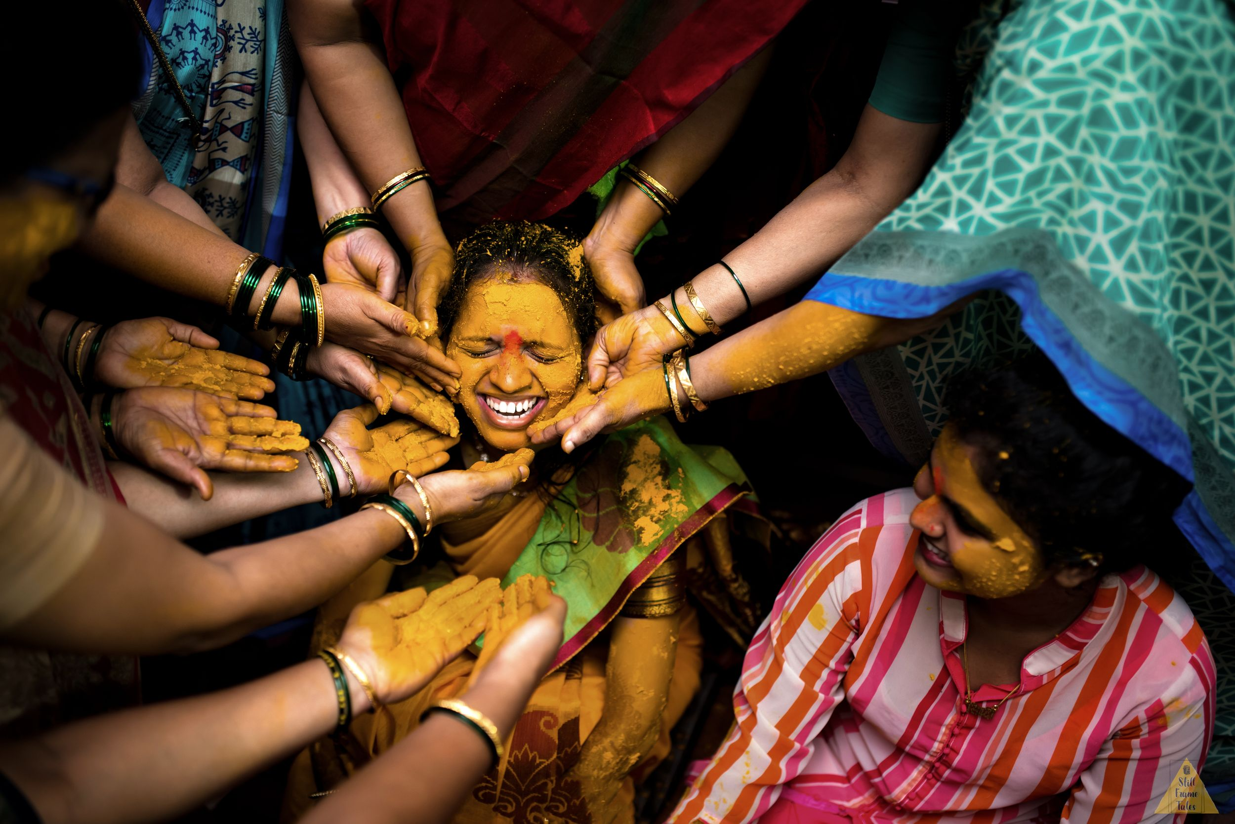 Friends & Family all together put haldi on bride's face
