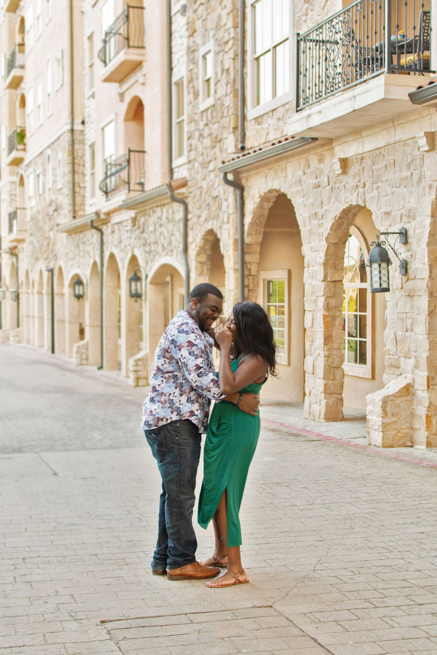 Couple dances in the street in Adriatica Village. Travel photography by award winning photographer Gernelle Nelson