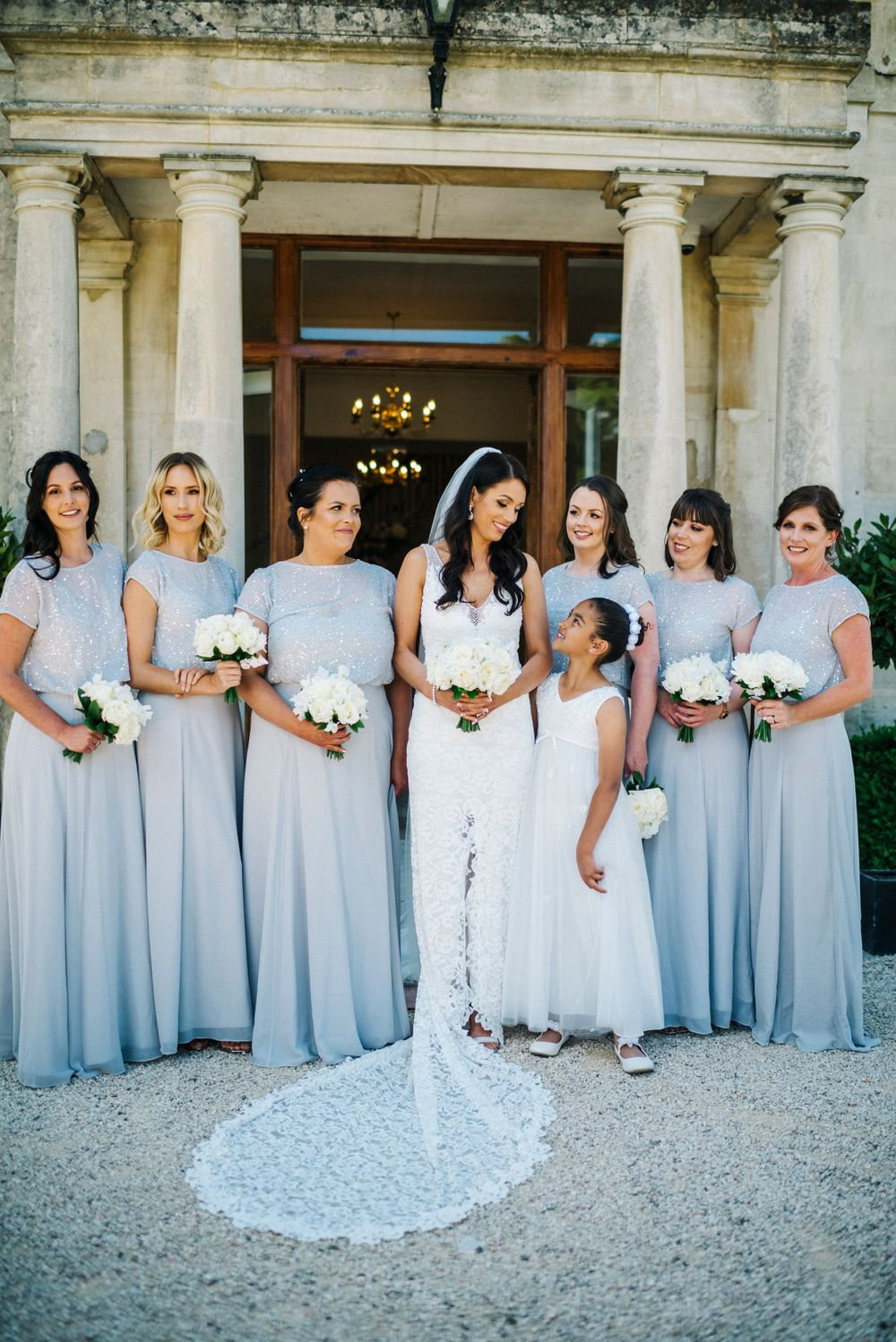 Bride and bridesmaids, Cotswolds wedding photographer, grace loves lace wedding dress, lace train, bridesmaids in blue