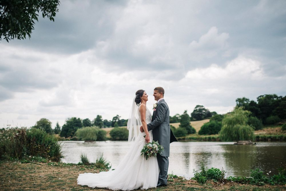 The Ashes Barn wedding venue, bride and groom portrait, couples portrait by a lake,  The Ashes barn wedding photography