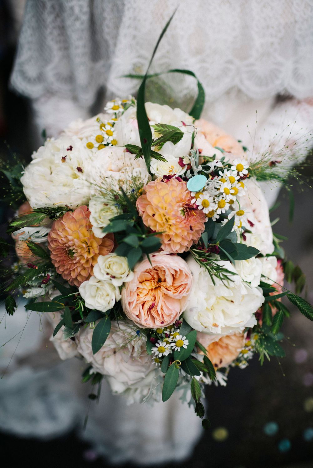 boho wedding, boho wedding bouquet, bouquet with confetti on, orange wedding flowers, boho bride