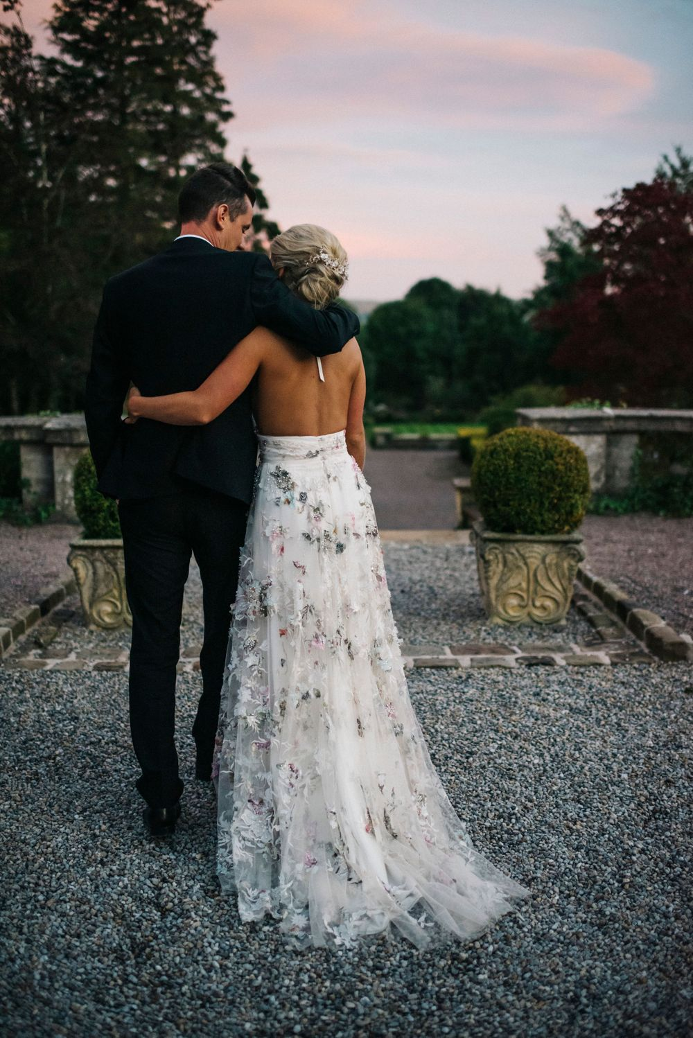 Eaves Hall, bride and groom at sunset, relaxed wedding photography, colourful wedding dress, backless wedding dress
