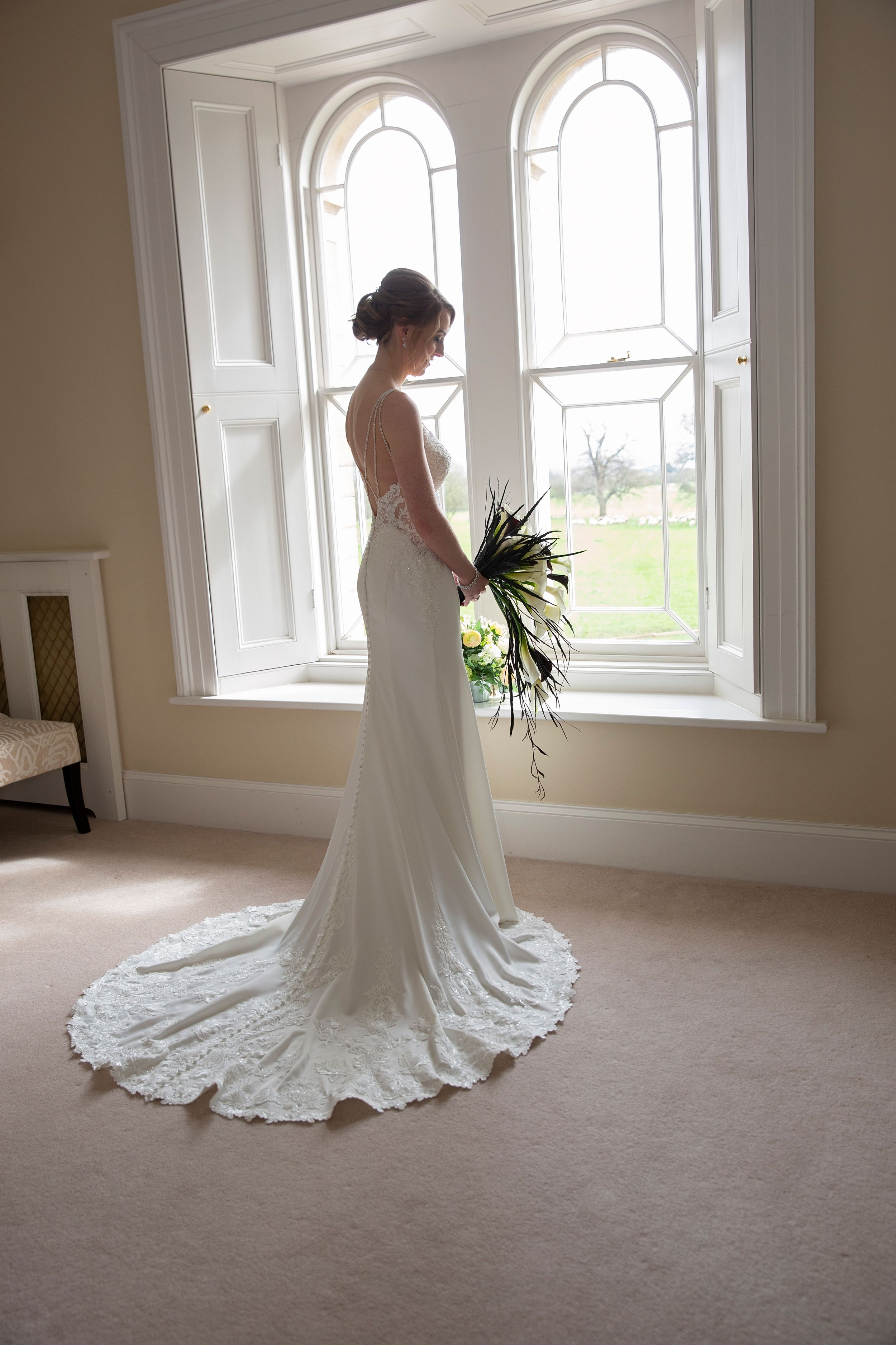 Bride and her bouquet at St Tewdrics House Chepstow