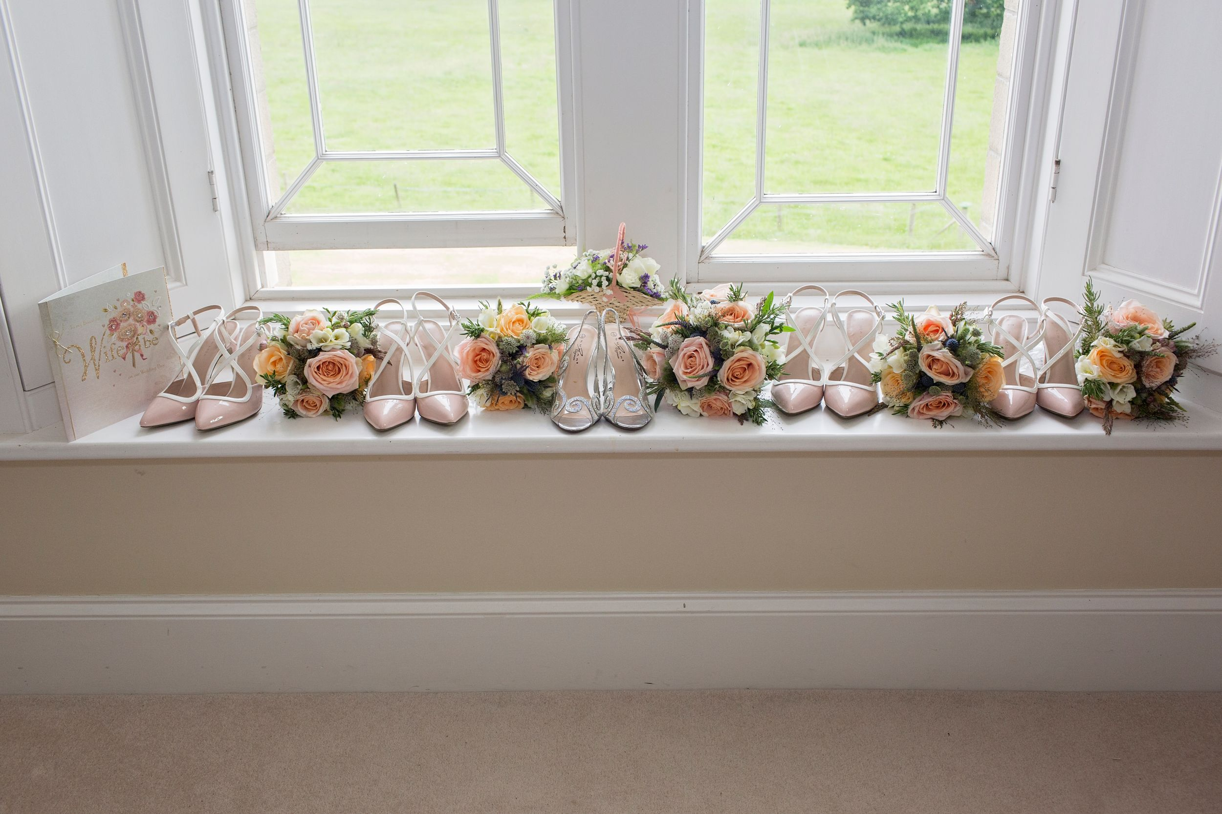 wedding flowers on the window sill at St Tewdrics Wedding