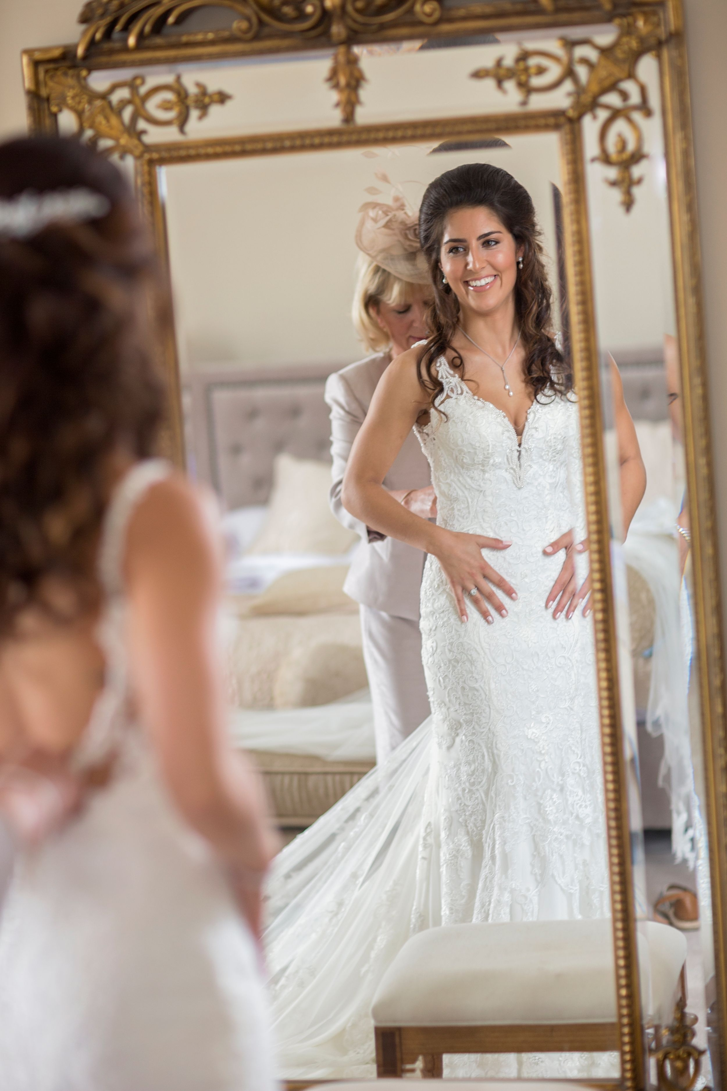 gorgeous bride and her mum getting ready in mirror at St Tewdrics House Chepstow