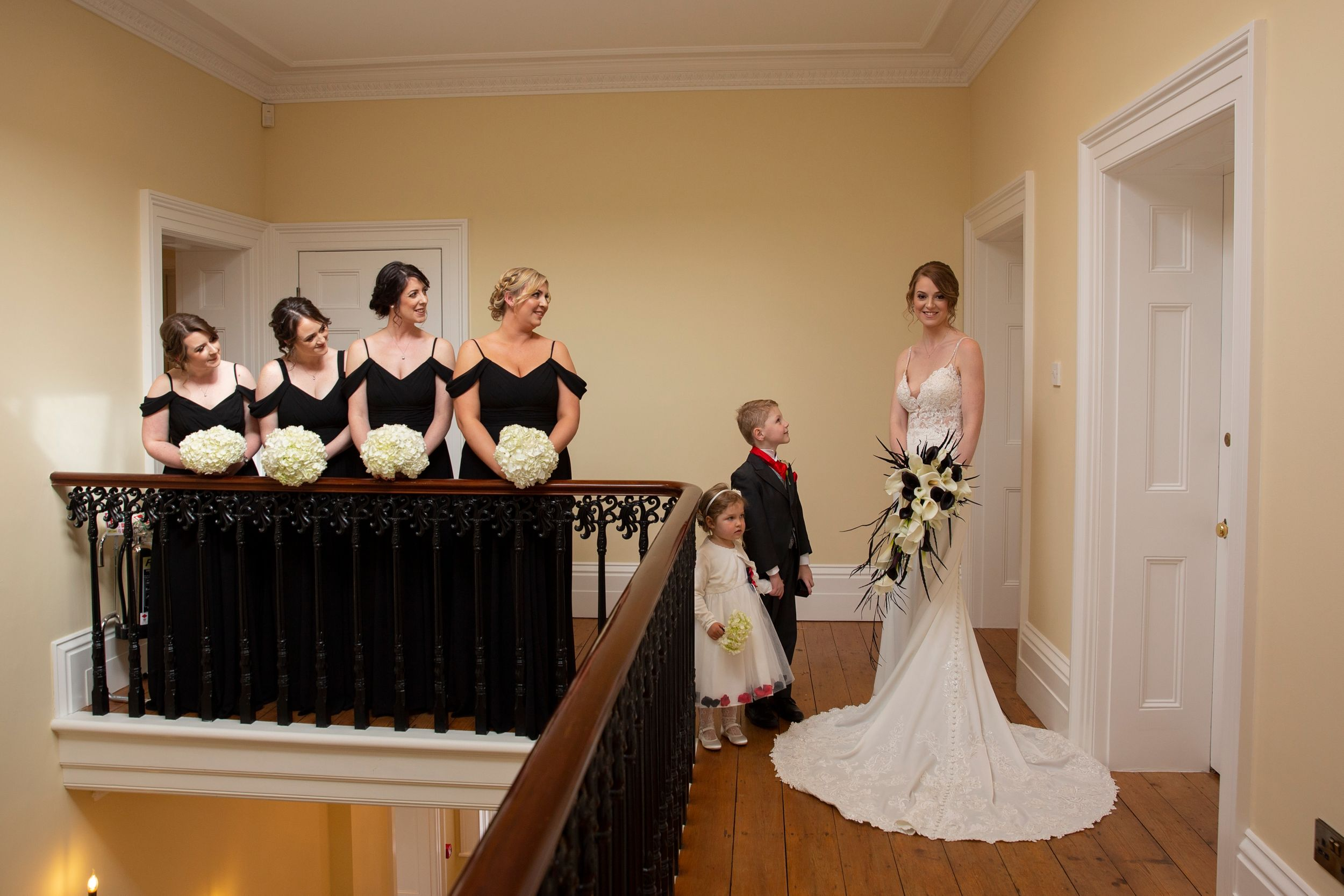 Bride and her Bridesmaid on stairs at St Tewdrics House