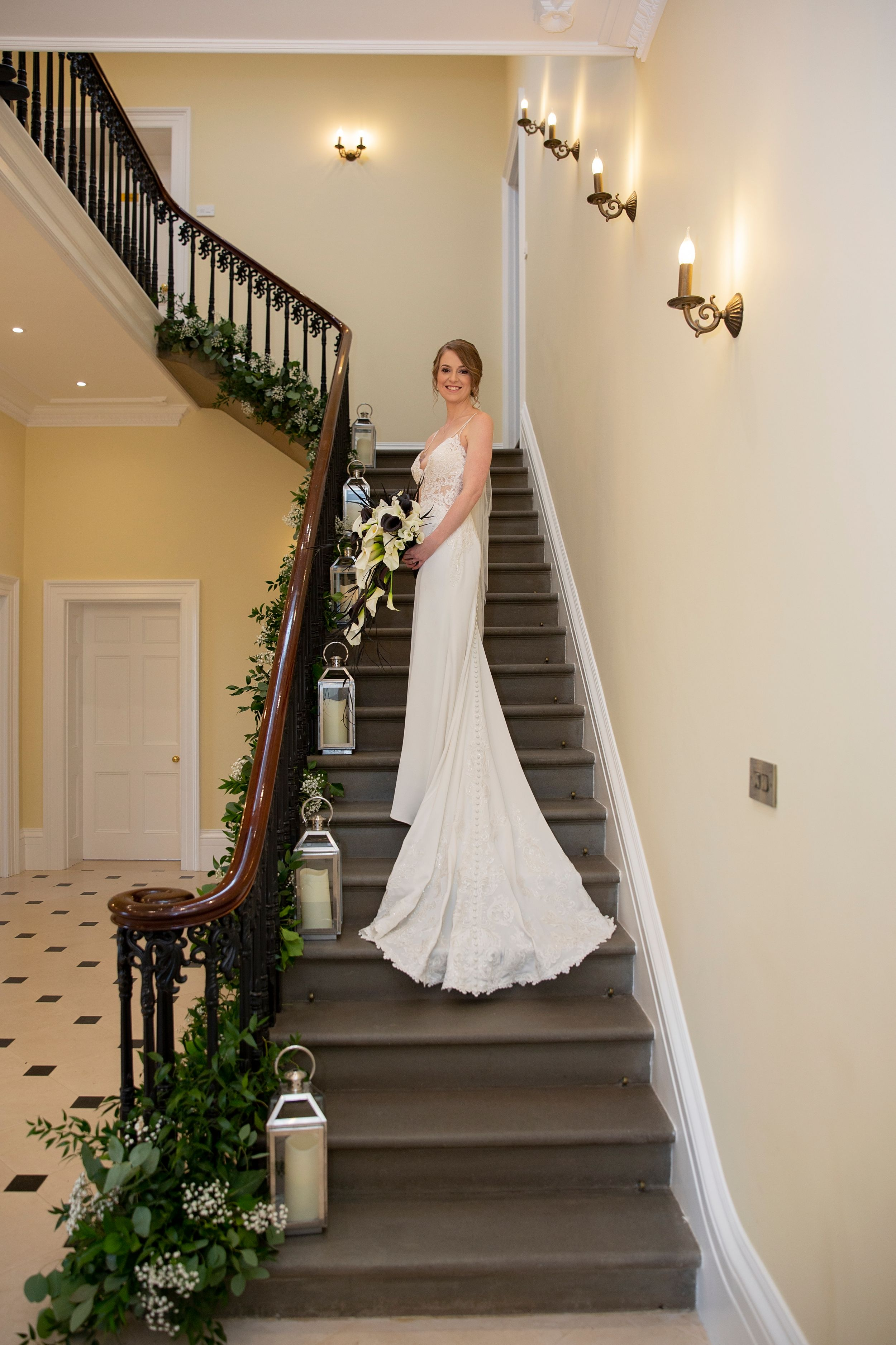 great staircase wedding photo of bride at St Tewdrics House Chepstow
